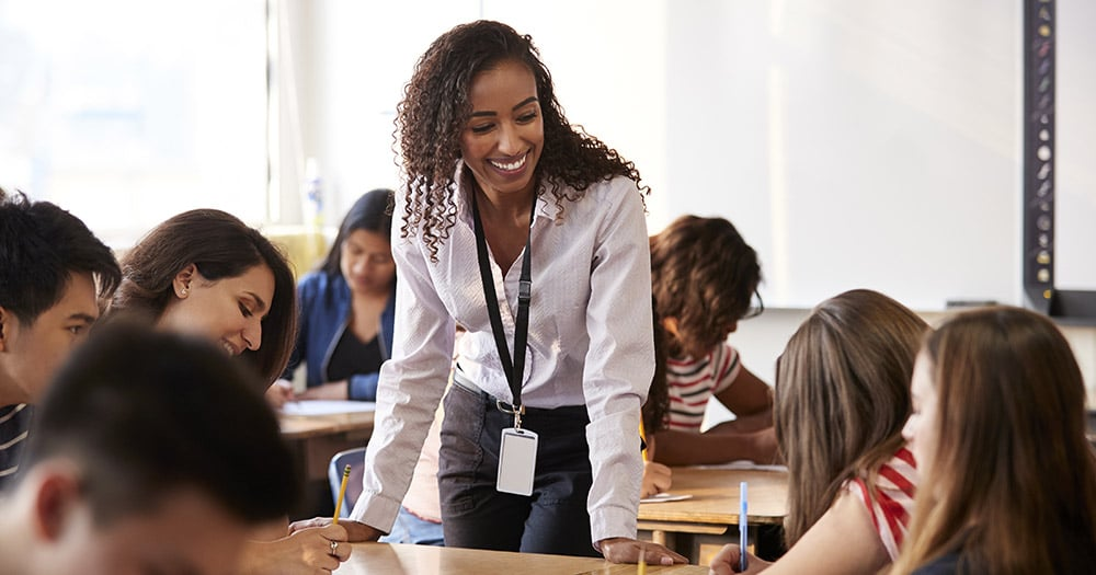 Successful teacher smiling in class